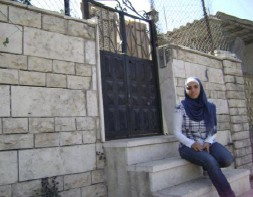 Sharihan Hanoun on the steps of her former house